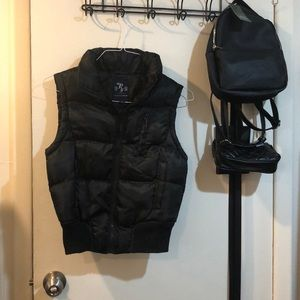 Black puffer vest with pockets
